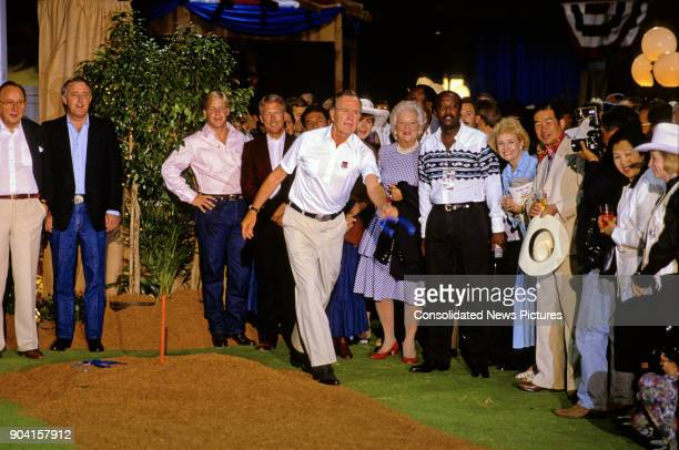 President George HW Bush plays a game of horseshoes during a reception prior to the 16th G7 Summit , Houston, Texas, July 8, 1990. Among those in the...