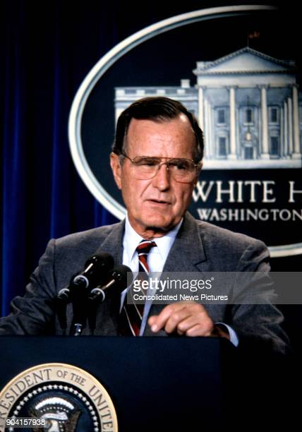 President George HW Bush speaks during a press conference in the White House's Brady Press Briefing Room, Washington DC, August 17, 1990.