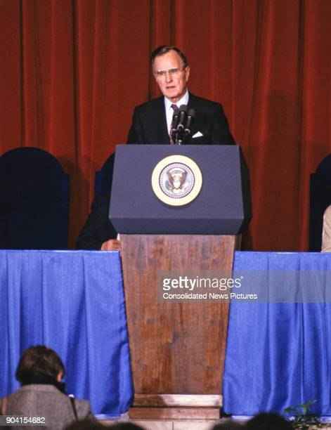 President George HW Bush speaks from a lectern, Washington DC, February 8, 1989. He was speaking at the swearing-in ceremony of Manuel Lujan Jr as US...