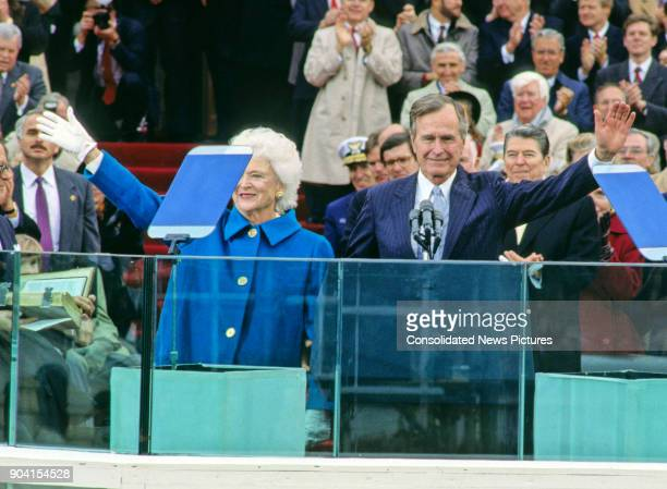 President George HW Bush waves as he delivers his Inaugural Address at the US Capitol, Washington DC, January 20, 1989. Waving beside him, though...