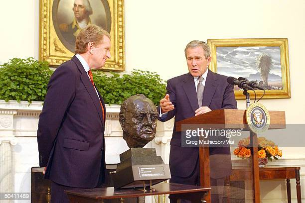President George W Bush accepting loan of a bust of British Prime Minister Winston Churchill from British Ambassador Sir Christopher Meyer in the...
