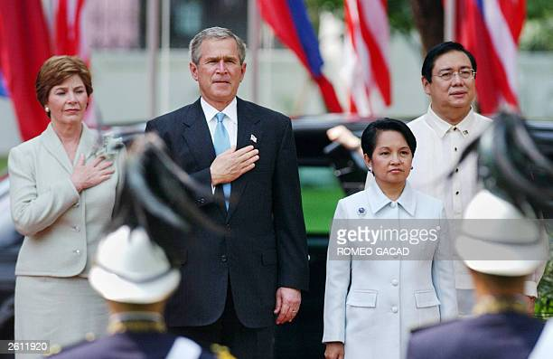 President George W Bush accompanied by US First Lady Laura Bush and Philippine President Gloria Arroyo accompanied by husband Jose Miguel Arroyo give...
