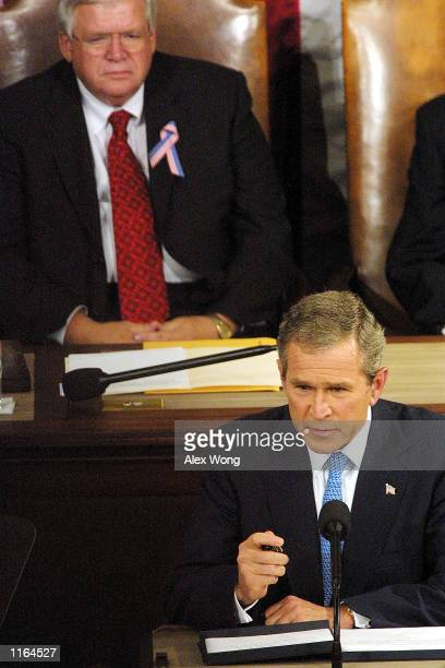 President George W Bush addresses a joint session of Congress as Speaker of the House Dennis Hastert left looks on September 20 2001 on Capitol Hill...