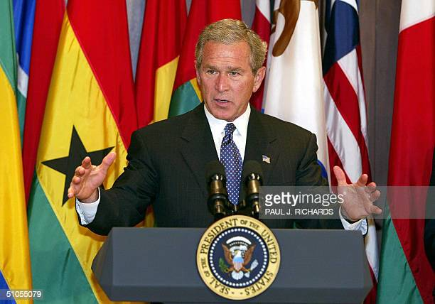 President George W Bush addresses guests 13 July shortly before signing the African Growth and Opportunity Act of 2004 at the Eisenhower Executive...