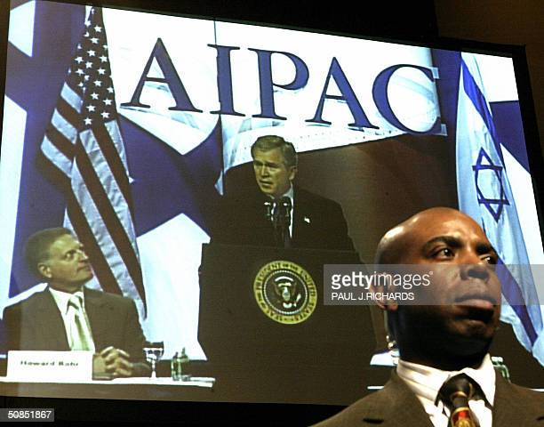 President George W Bush addresses the American Israel Public Affairs Committee as an unidentified US Secret Service Agent watches the crowd 18 May...