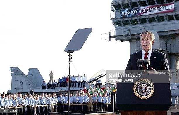 US President George W Bush addresses the nation aboard the nuclear aircraft carrier USS Abraham Lincoln 01 May as it sails for Naval Air Station...
