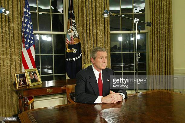 S President George W Bush addresses the nation March 19 2003 in the Oval Office of the White House in Washington DC Bush announced that the US...