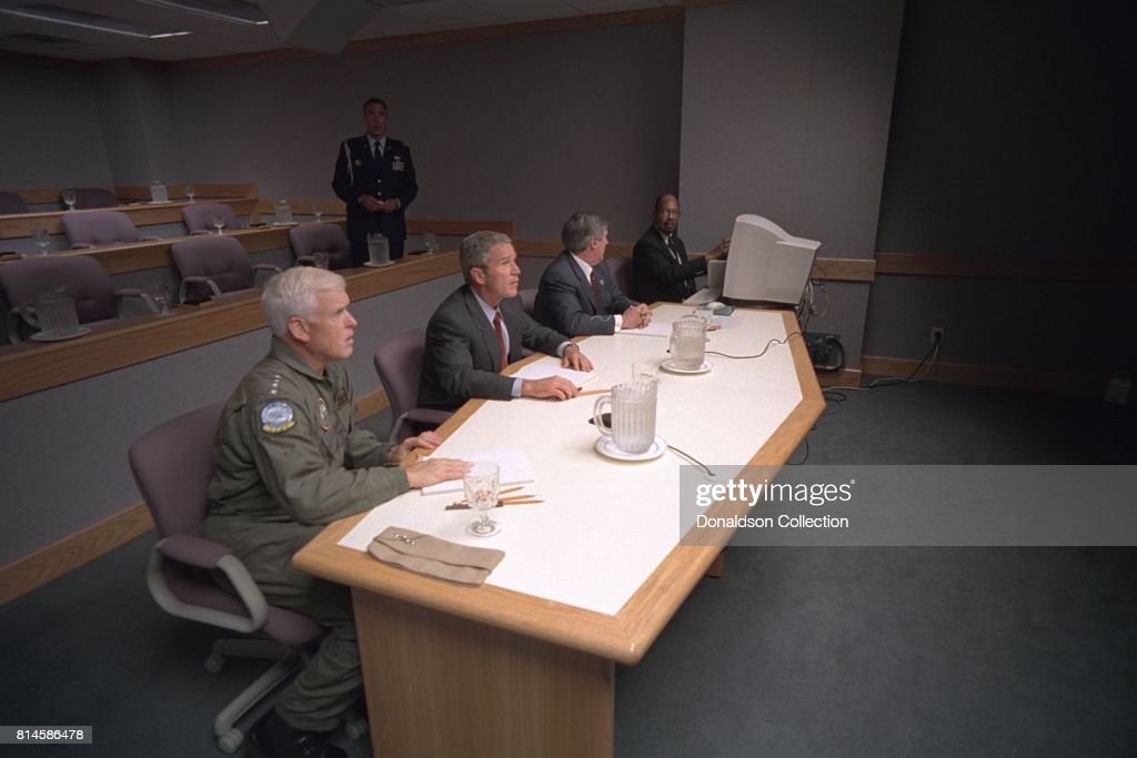 President George W. Bush, Admiral Richard Mies, left, and White House Chief of Staff Andy Card conduct a video teleconference Tuesday Sept. 11, 2001, at Offutt Air Force Base in Nebraska. Photo by Eric Draper, Courtesy of the George W. Bush Presidential Library/Getty Images