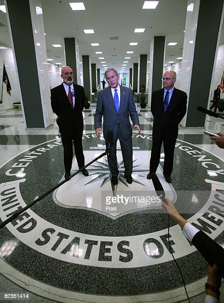 S President George W Bush after a briefing at CIA headquarters as CIA Deputy Director Steve Kappas and CIA Director Micahel V Hayden listen August 14...