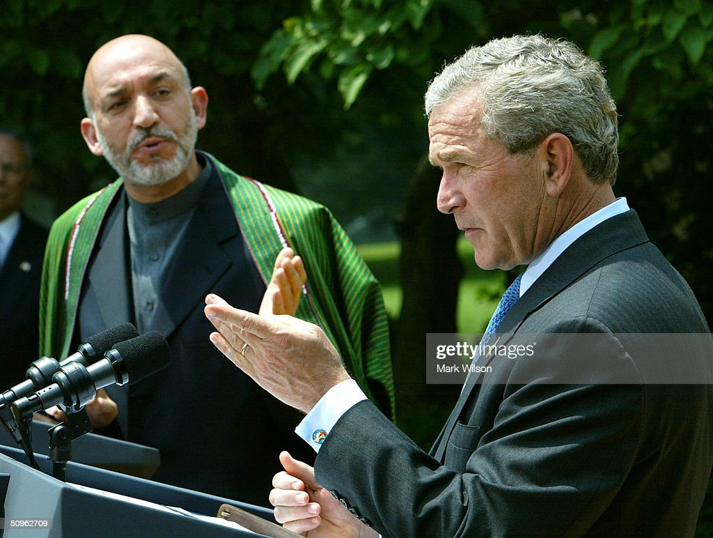 U.S. President George W. Bush (R) and Afghan President Hamid Karzai speak to reporters in the Rose Garden at the White House June 15, 2004 in Washington DC. The two leaders met to discuss the war on terrorism.