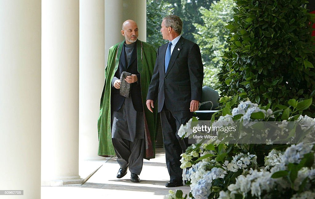 U.S. President George W. Bush (R) and Afghan President Hamid Karzai walk out of the Oval Office before speaking to reporters in the Rose Garden at the White House June 15, 2004 in Washington DC. The two leaders met to discuss the war on terrorism.