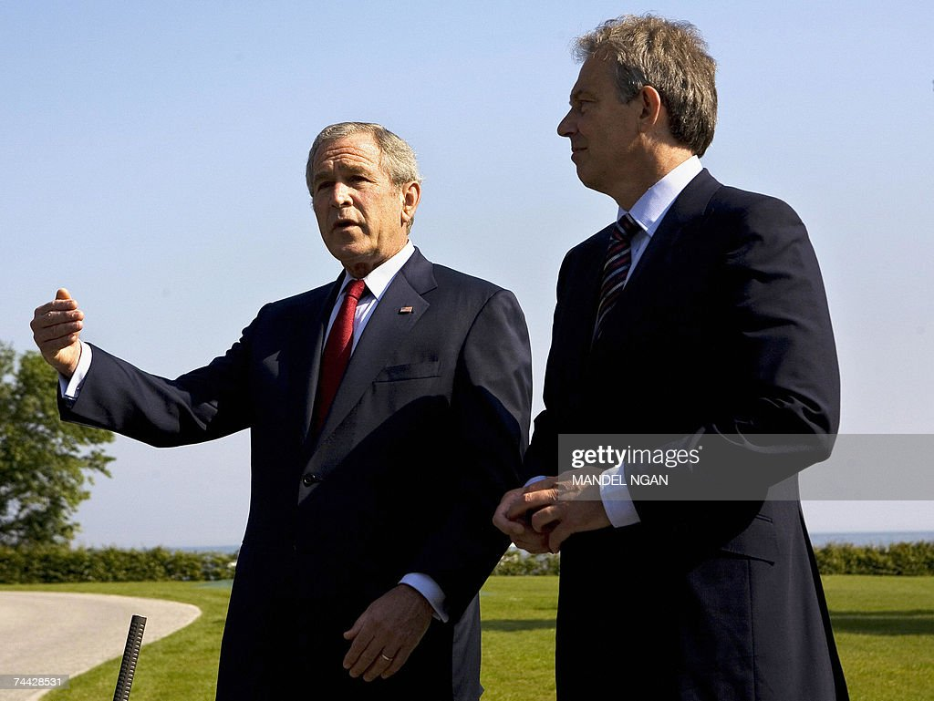 US President George W. Bush and Britain?s Prime Minister Tony Blair address journalists following a bilateral meeting 07 June 2007 on the sidelines of the G8 Summit in Heiligendamm, northeastern Germany. AFP PHOTO/Mandel NGAN