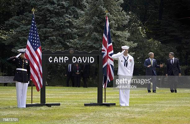 President George W. Bush and British Prime Minister Gordon Brown arrive for a joint press conference at Camp David, Maryland, 30 July 2007. Bush said...