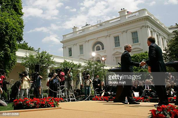 President George W Bush and British Prime Minister Tony Blair at a news conference at the Rose Garden of the White House in Washington DC Bush and...