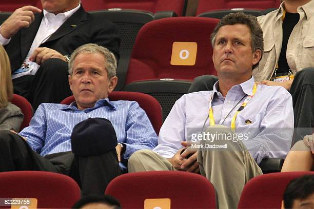 US President George W Bush and brother Marvin Bush watch the women's preliminary basketball game between the United States and Czech Republic at the...