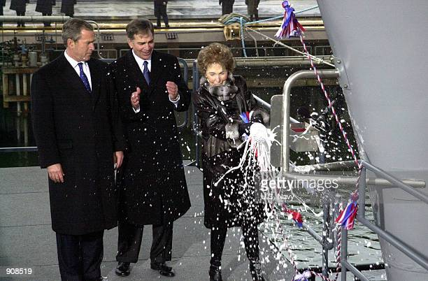 S President George W Bush and Chairman and Chief Executive Officer of Newport News Shipbuilding William P Frick watch as former First Lady Nancy...