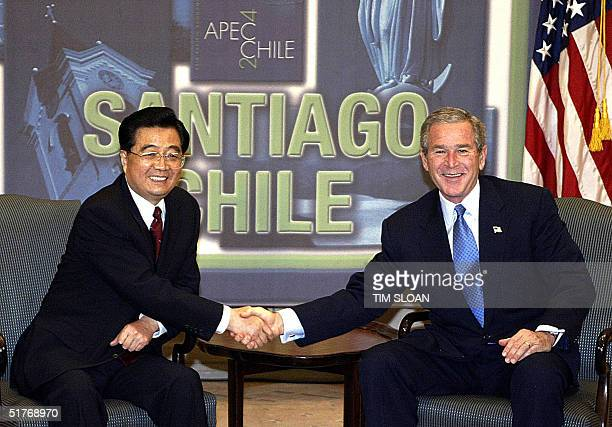 President George W. Bush and Chinese President Hu Jintao participate in a bilateral meeting before the opening session of the annual APEC meetings 20...