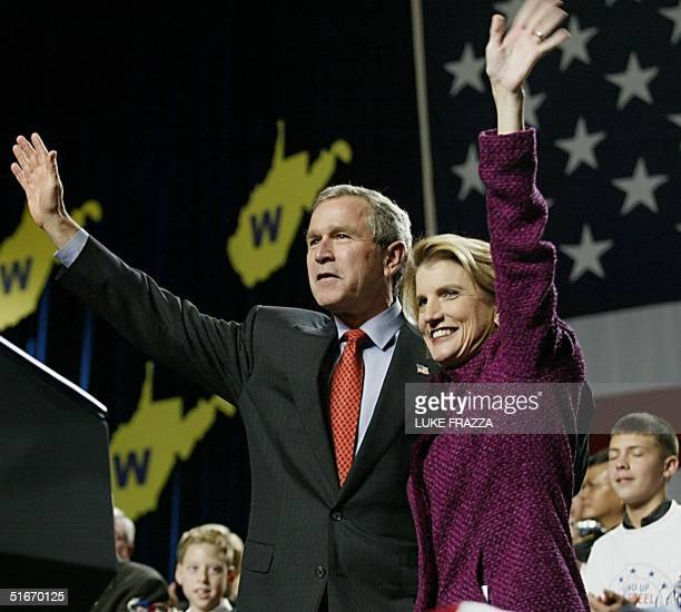 President George W Bush and Congresswoman Shelley Moore Capito wave to supporters at a campaign rally at Charleston Civic Center Charleston West...