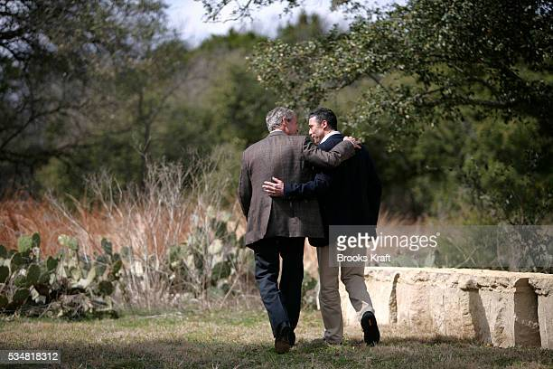 President George W Bush and Danish Prime Minister Anders Fogh Rasmussen right leave together following a joint news conference at Bush's ranch near...