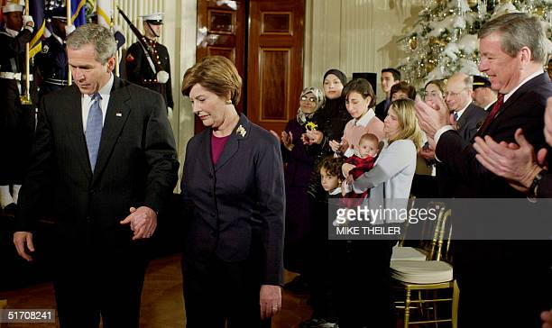 President George W Bush and first lady Laura arrive for a The World Will Always Remember ceremony in the East Room of the White House 11 December...