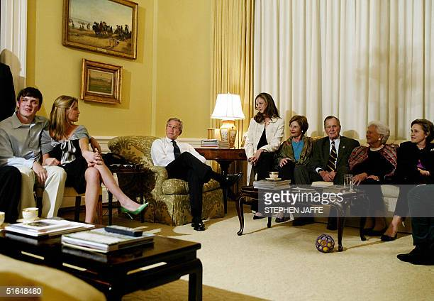 President George W Bush and First Lady Laura Bush are joined by daughters Barbara Jenna nephew Sam LeBlond former US president George H Bush and his...
