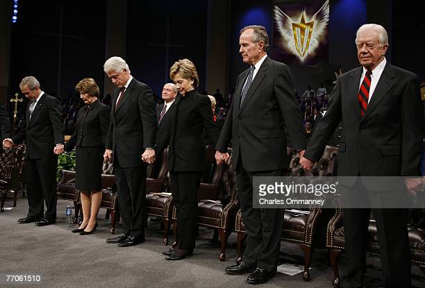 President George W Bush and First Lady Laura Bush are joined by former President Bill Clinton US Senator Hillary Clinton former President George HW...