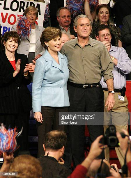 President George W Bush and First Lady Laura Bush arrive to the Republican Florida Victory 2006 Rally on Monday November 6 at the Pensacola Civic...