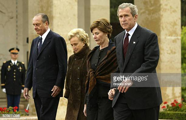 US President George W Bush and First Lady Laura Bush attend a Memorial Day Commemoration at Normandy American Cemetery in CollevillesurMer France...