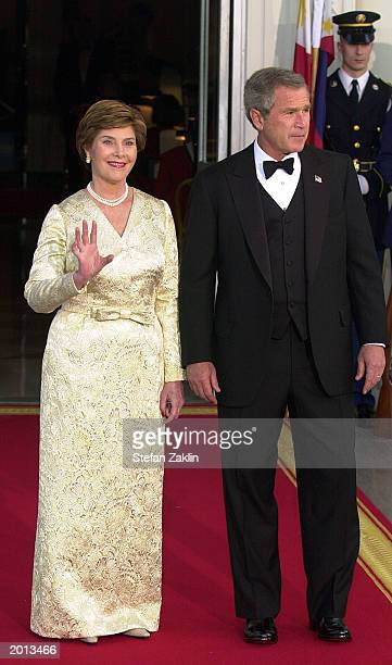 President George W. Bush and First Lady Laura Bush await the arrival of President of the Republic of the Philippines Gloria Macapagal-Arroyo and her...
