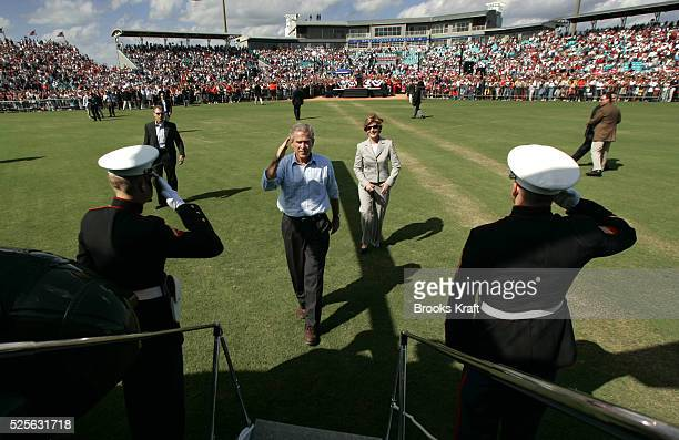 President George W Bush and first lady Laura Bush board Marine One after a campaign rally in Melborne Florida October 23 2004