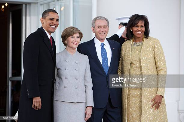 President George W Bush and First Lady Laura Bush greet Presidentelect Barack Obama and Michelle Obama at the North Portico of the White House where...
