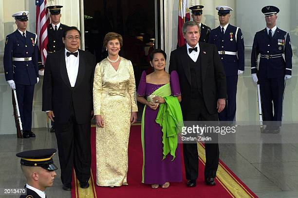 President George W. Bush and First Lady Laura Bush join President of the Republic of the Philippines Gloria Macapagal-Arroyo and her husband Jose...