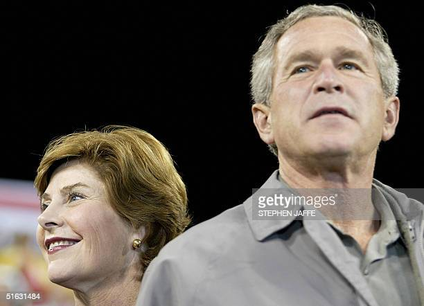 President George W. Bush and First Lady Laura Bush look out on the crowd at Great American Ball Park 31 October 2004 in Cincinnati, Ohio. Bush is on...