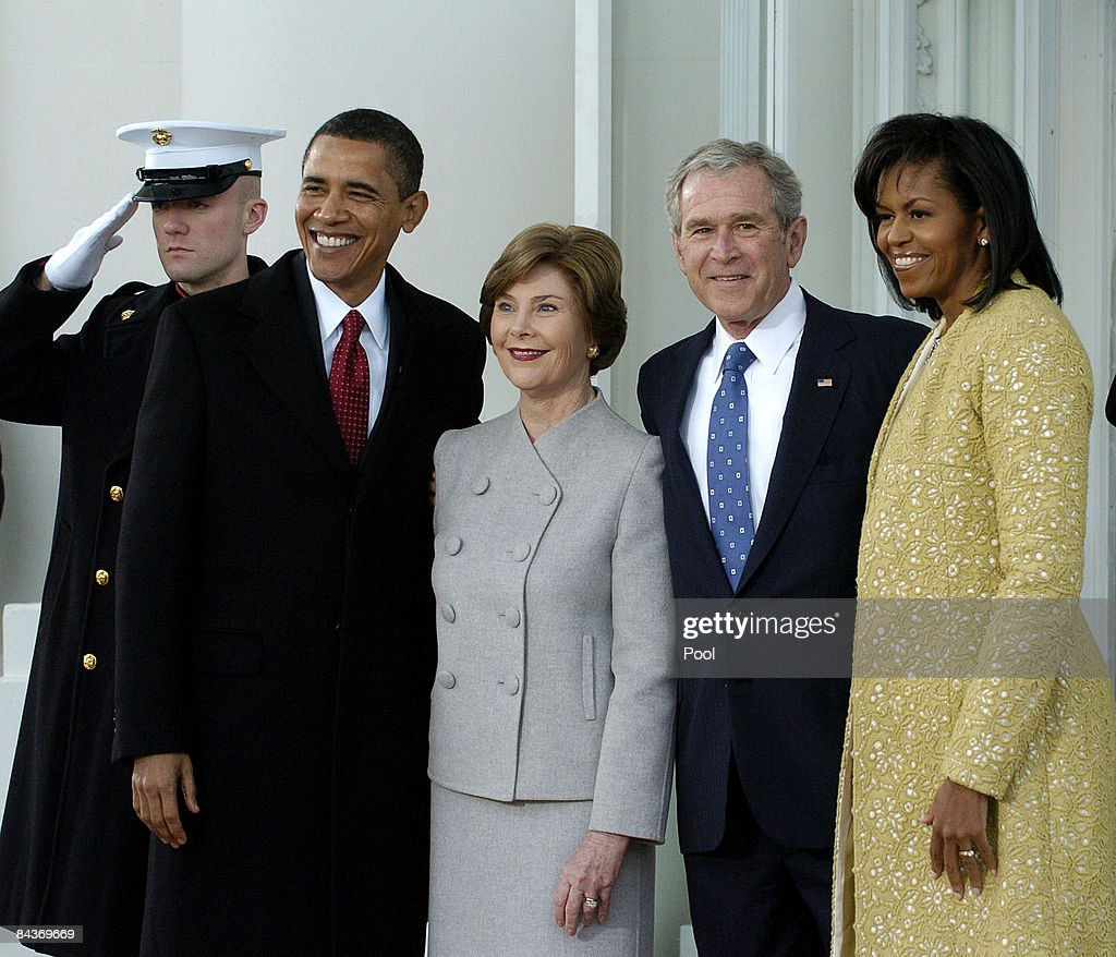 U.S. President George W. Bush (2nd R) and First Lady Laura Bush (C) , pose with President-elect Barack Obama (2nd L) and Michelle Obama as they at the White House in the North Portico, before Obama's Inauguration as the 44th president of the United States of America January 20, 2009 in Washington, DC. Obama will be sworn in as the first African-American president of the U.S.