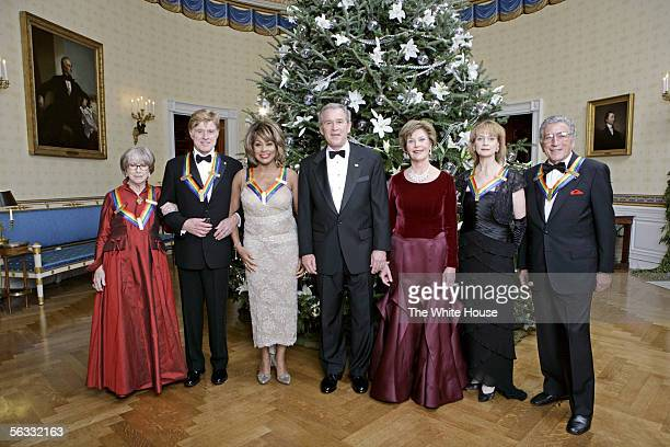 S President George W Bush and first lady Laura Bush stand with the Kennedy Center honorees actress Julie Harris actor Robert Redford singer Tina...