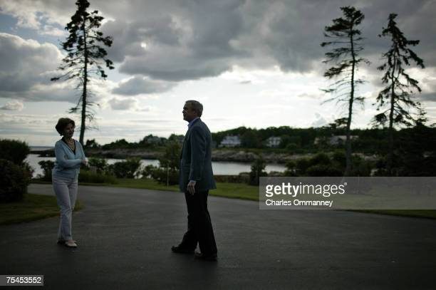 President George W Bush and First Lady Laura Bush wait outside the main house of the Bush family estate at Walker's Point for the arrival of Russian...