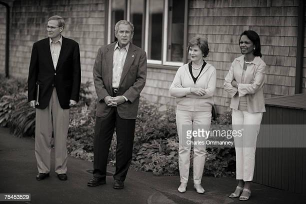 President George W Bush and First Lady Laura Bush wait with US Ambassador to Russia William Burns US National Security Advisor Stephen Hadley US...