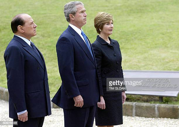 President George W Bush and First Lady Laura Bush walk with Italian Prime Minister Silvio Berlusconi to lay a wreath at Fosse Ardeatine the site of a...