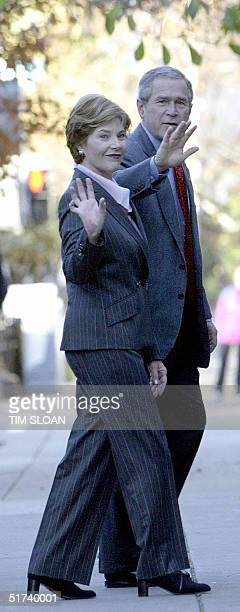 President George W Bush and First Lady Laura Bush wave as they depart St John's Church after attending the Sunday morning service 14 November 2004 in...