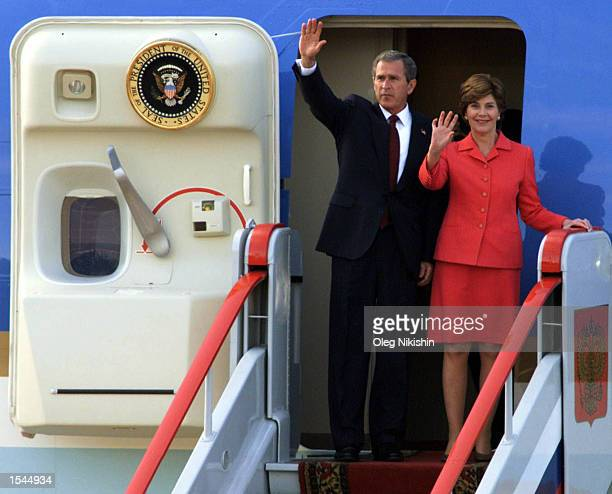 S President George W Bush and first lady Laura Bush wave to admirers after arriving at Vnukovo airport May 23 2002 in Moscow Russia Bush is in Moscow...