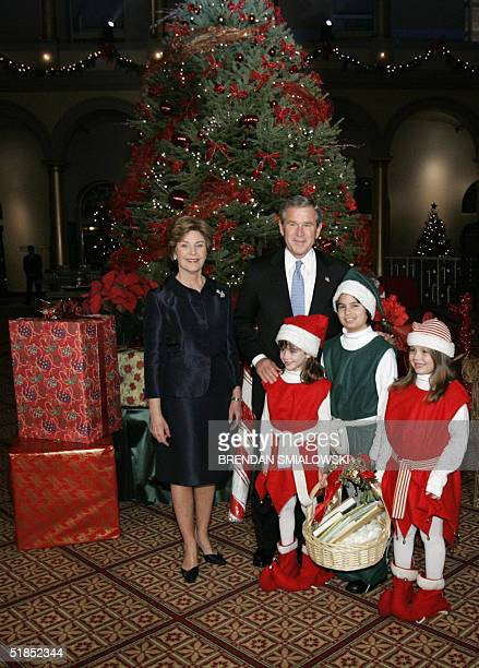 President George W Bush and First Lady Laura pose with Brook Allen daughter of Senator George Allen Marco Spencer Gallisa and Milena Spencer Gallisa...