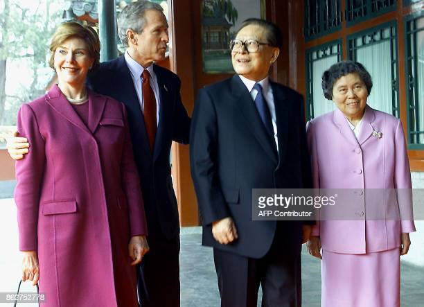 US President George W Bush and First Lady Laura together with Chinese President Jiang Zemin and his wife Wang Yeping pose for a photograph prior to a...