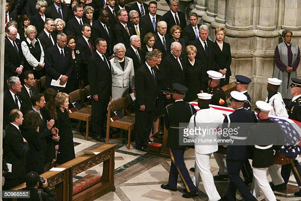 US President George W Bush and former presidents Clinton Bush Ford and Carter watch the casket of Ronald Reagan leave after funeral services for the...