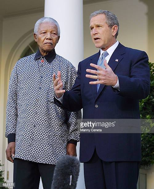 President George W. Bush and former South African president Nelson Mandela offer their condolences to the relatives of the victims of the American...