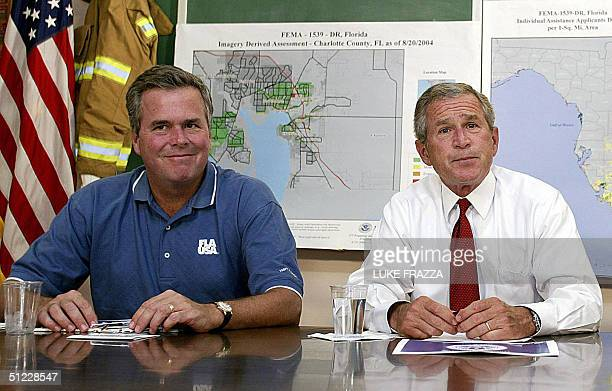 President George W Bush and his brother Florida Governor Jeb Bush participate in a briefing on Tropical Storm Bonnie and Hurricane Charley 27 August...