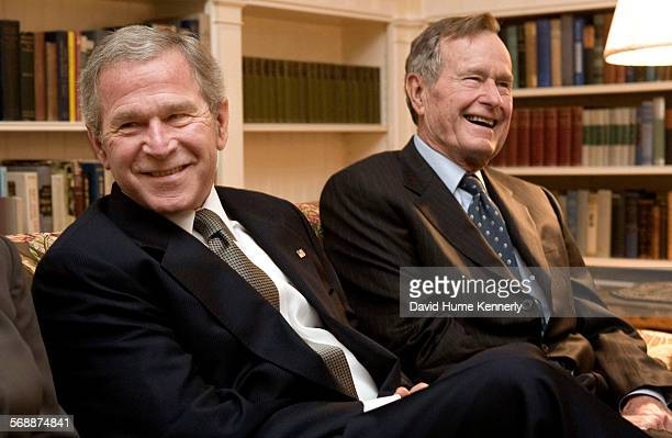 President George W Bush and his dad former President George HW Bush at the Blair House in Washington DC visiting the Ford family after the death of...