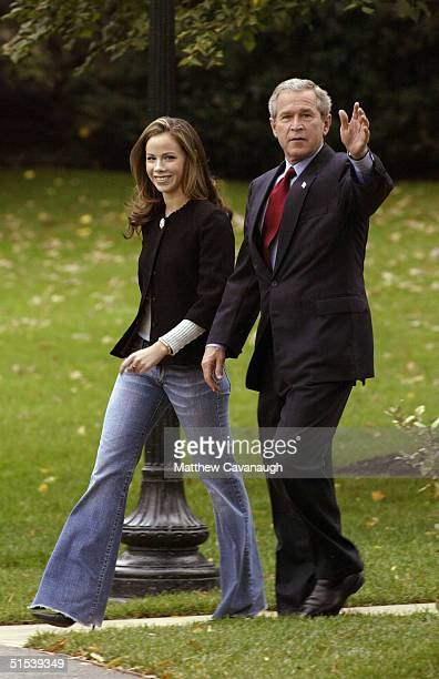 S President George W Bush and his daughter Barbara Bush leave the White House October 22 2004 in Washington DC Bush is depaeting for a multistate...