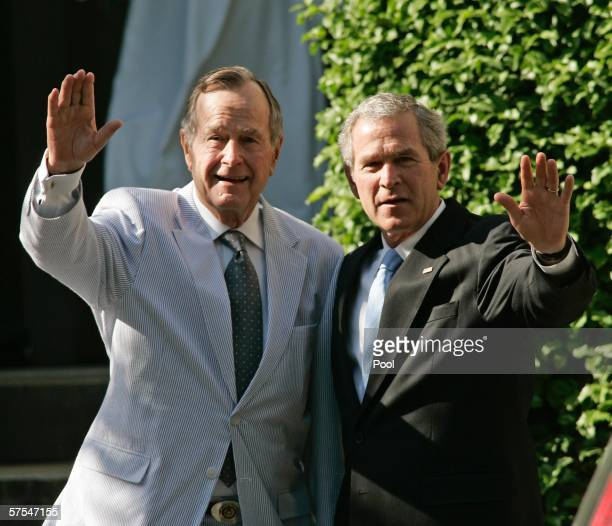 S President George W Bush and his father former US President George Bush wave as the leave a family wedding at St John's Episcopal Church May 6 2006...