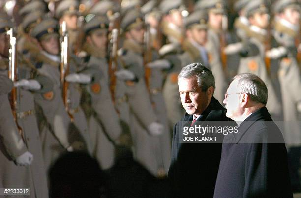 President George W. Bush and his Slovak counterpart Ivan Gasparovic examine guard of honour at MR Stefanik's airport in Bratislava 23 February 2005,...