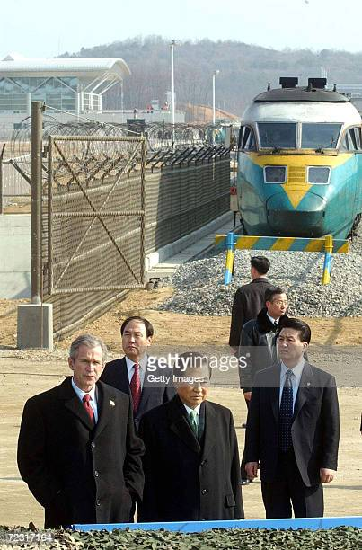 S President George W Bush and his South Korean counterpart Kim DaeJung visit the Demilitarized Zone February 20 2002 between North and South Korea at...